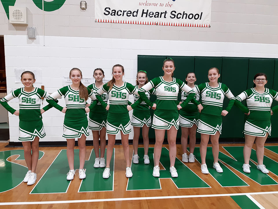 Shamrock cheerleaders smiling for the camera